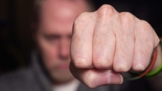 Man with his fist raised - Violent Crimes in California